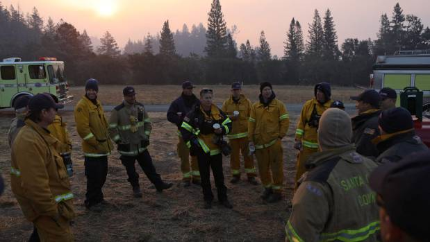 Firefighters meet to plan the day outside Calistoga, California.
