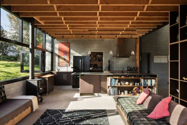The other end of the house, which faces the street, provides a family living space off the kitchen.