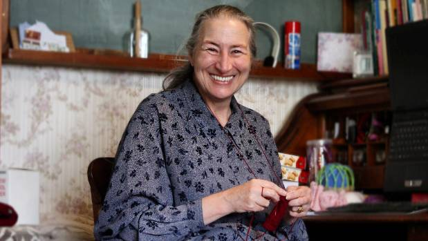 Megan Mills has been running a free knitting group out of her Western Springs home for more than 10 years.