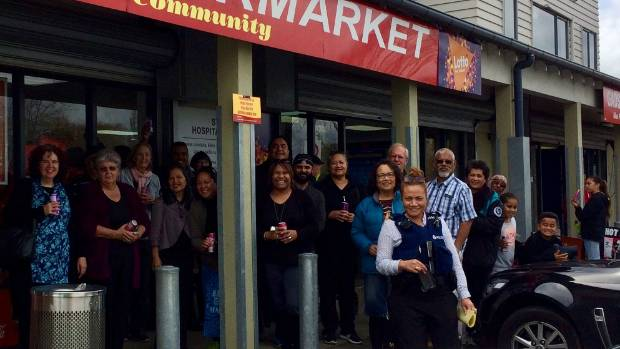 Nearby residents and customers of the Gadsby Supermarket in Māngere came to show support for the store.