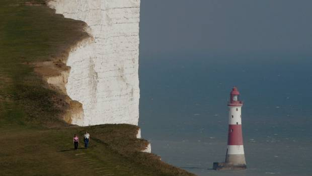 Student fell to her death from clifftop while leaping for photo