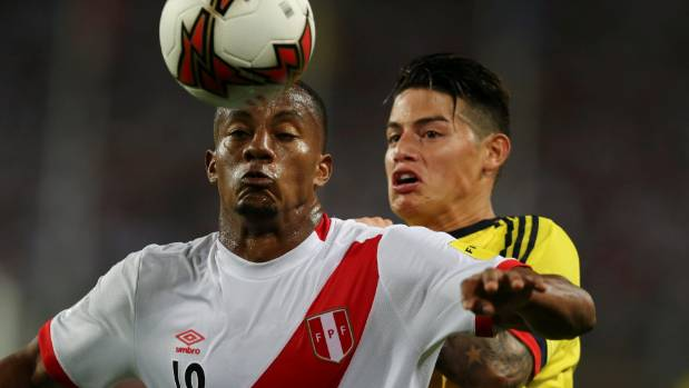 Peru's Andre Carrillo and Colombia's James Rodriguez in action during their South American World Cup qualifier that ...