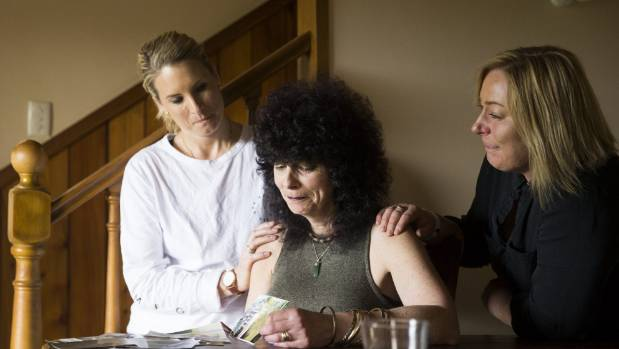 Caroline Paterson, centre, is comforted over the death of her mother by former Aspen registered nurse Rebecca du ...