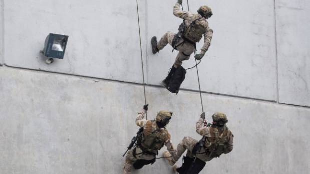 SAS members abseil down a wall at the opening of the new Special Operations Battle Training Facility in April 2016 in ...