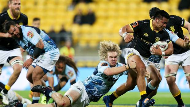 Northland's Josh Goodhue can only cling on for dear life as Wellington's Asafo Aumua rampages upfield at Westpac Stadium.