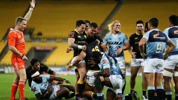 It's another Wellington try and Asafo Aumua emerges with the ball, assisted by Carlos Price, left, and Alex Fidow during ...