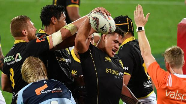 Wellington's 10th bonus point try from as many matches in 2017 is scored by Alex Fidow as captain Brad Shields, left, ...