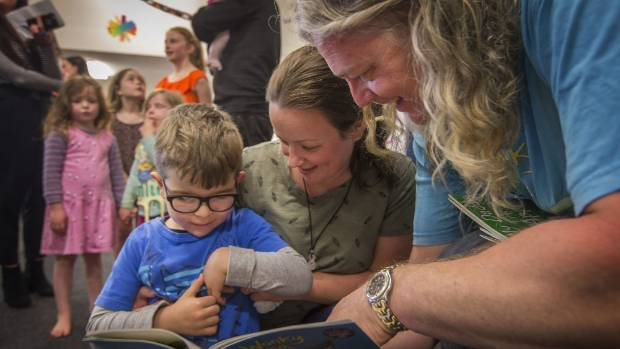 Eli Bedford and Mum Rachel Bedford meet with children's author Craig Smith.