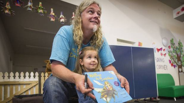 Ava Ackerman, 3, was excited to have her book personally signed by Craig Smith.