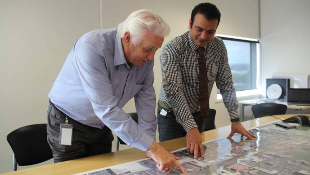 Auckland Transport's Dai Bindoff, left, and Zaid Essa look at plans for the upgrade.