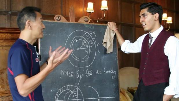 Mathematician Ken Ono, left, working on set of the film The Man Who Knew Infinity, with actor Dev Patel.