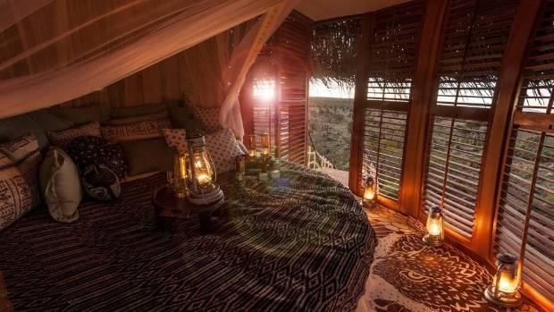 Naturally, the circular cabin boasts a circular bed and mosquito net.