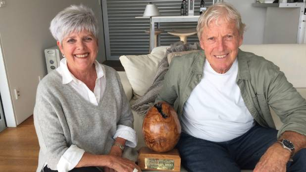 Grahame and Prue Taylor with their olive shaped trophy.