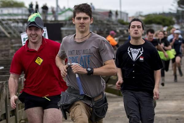 Josh Kowalewski from Design Builders leads the Gumboot Race.