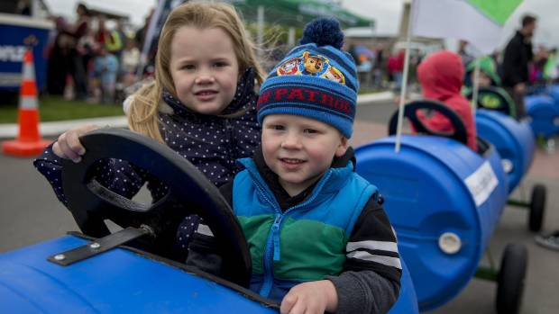 Maia, 5, and Liam Bearda, 2, wait for their ride.