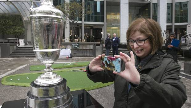 It's really here: Annie Harcourt checks out the prestigious Claret Jug, prize for the Open Championship, at Midland Park ...