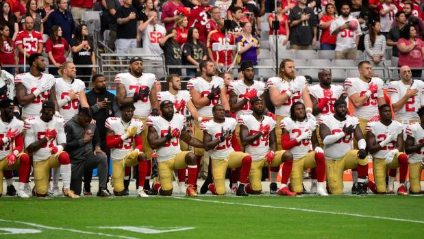 Donald Trump has criticised athletes for kneeling during the US national anthem in recent weeks.