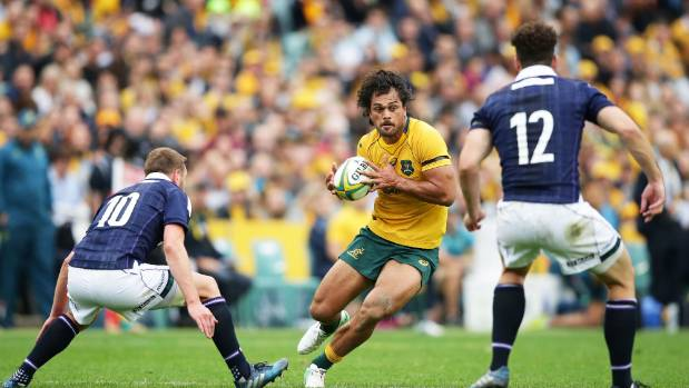 Karmichael Hunt, centre, backs the Wallabies to get the job done against the All Blacks next week.