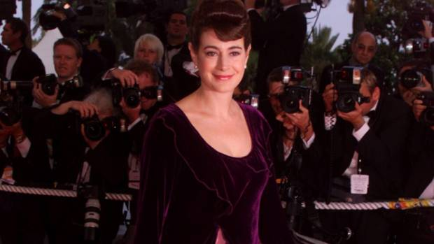 Sean Young twirls her gown as she arrives on the steps at the palace for the closing ceremonies and the awarding of the ...