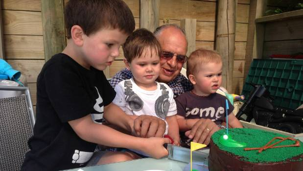 Calavrias celebrates his birthday with grandchildren, from left, Zack, Dimitri and Louie.
