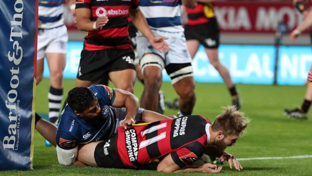 Braydon Ennor of Canterbury dives over for his 10th try of the season on Friday night against Auckland.