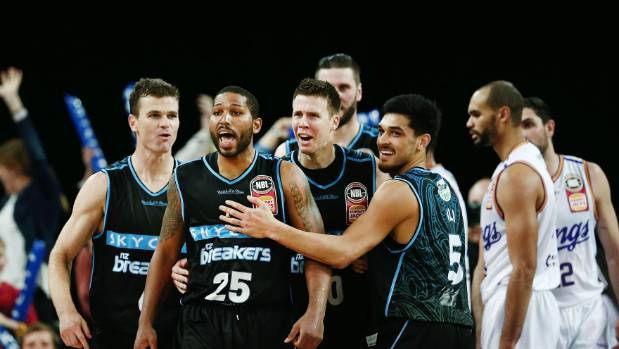 DJ Newbill yells with delight after scoring the winning basketball to give the New Zealand Breakers victory over the ...