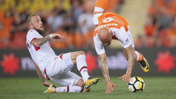 Daniel Adlung of Adelaide United (left) fouls Massimo Maccarone of the Brisbane Roar during their round two A-League match.
