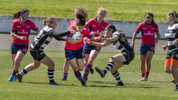 Midfielder Staci Kohe attempts to power through the defence during Tasman's Farah Palmer cup win over Hawke's Bay.