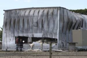 Bruce Rogers surveys the damage to his shearing shed after the fire on Monday night.