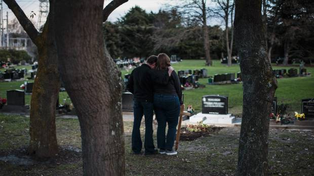 Carl and Margaret visit their son Jonny's grave after he died by suspected suicide in June.