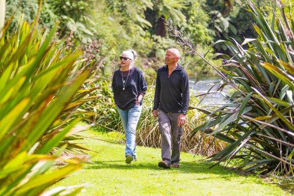 Diana Montgomery And John Wilmshurst By The River That Borders Much Of Their Garden