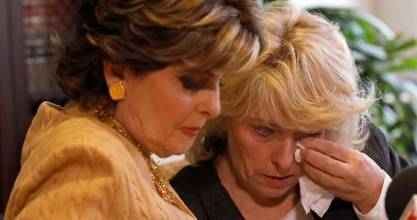 Lawyer Gloria Allred, left, comforts Heather Kerr at Friday's press conference.