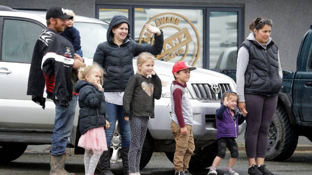 Watching the trucks on Bond St are, from left, Lyall Goodwright, holding Austin Goodwright, 1, Olivia Goodwright, 6, ...