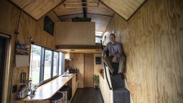 Sutherland's house is lined with plywood and features the typical tiny house layout, with a loft bedroom.