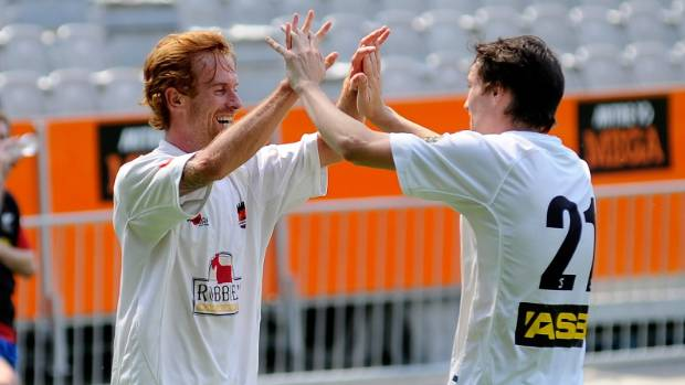 Aaron Clapham and former team-mate Shawn O'Brien are all smiles after a goal against Southern United in 2015.