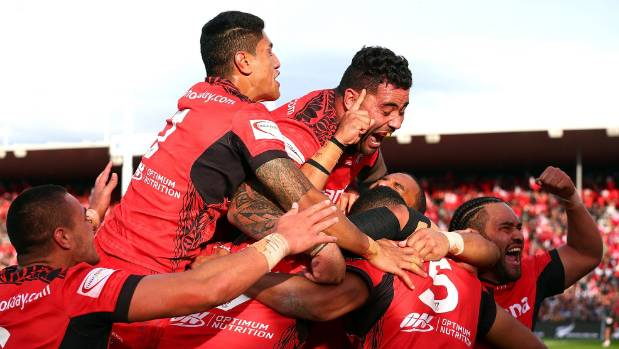 The Tongan Rugby League World Cup team celebrate after upsetting the Kiwis at Waikato Stadium.