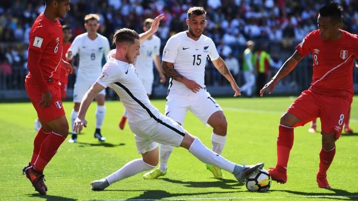 Kip Colway attracts the ball from Christian Cueva in the last World Cup against Peru.