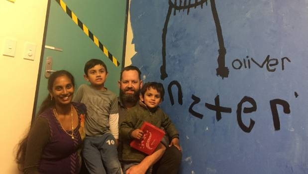 "Anita, Oliver, 6, Paul and George Knight, 3, in front of Oliver's artwork ""Monster""."