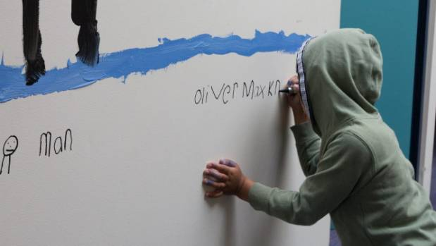 Oliver Knight, 6, creating one of his many artworks scattered around the PSUSI building.