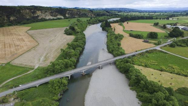 The Ruamahanga River flows past farmland at Gladstone Bridge, one of GWRC's measuring points.