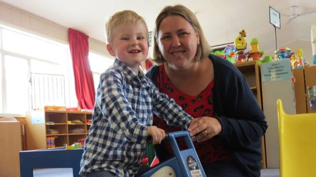 Toby Hickson, 3, rides around the Christchurch Special Needs Library with mother Aynsley Hickson.