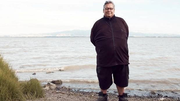 Ra Smith of Ngati Kahungunu ki Wairarapa stands by Lake Wairarapa.