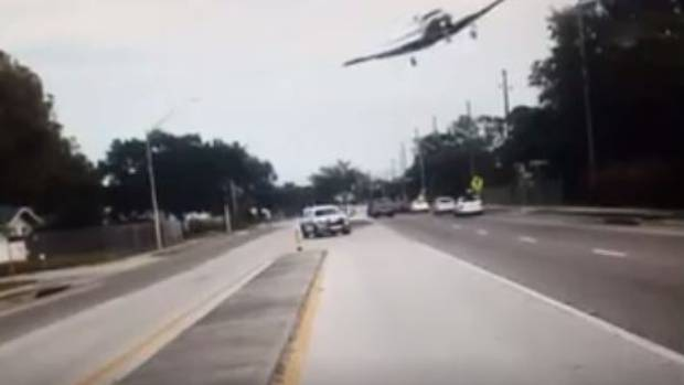 Dash cam captures plane flying dangerously low, then crashing on Florida road