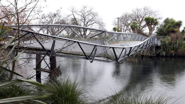 The twisted Medway St bridge over the Avon River before it was taken away for storage.