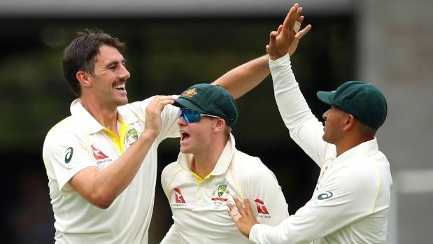 Fast bowler Pat Cummins of Australia took three wickets as England were dismissed for 302 on day two in Brisbane
