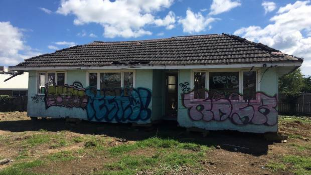 Graffiti written all over the derelict house might give police some clues as to where it's come from and why it's now sitting on a site ready for development in Takanini.