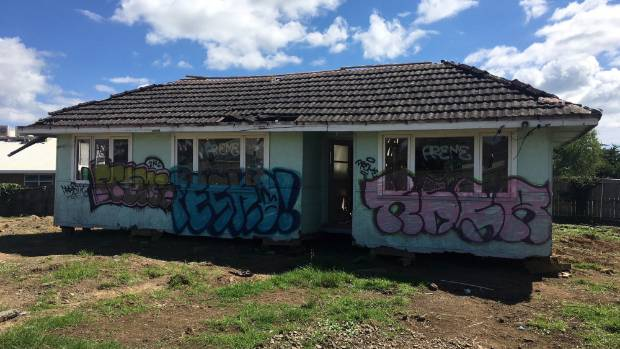 Dumped house demolished while dispute heads to court