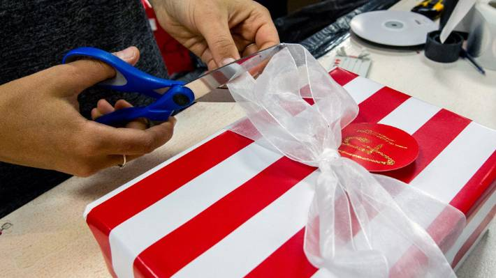 Wrapping paper with a shiny inside surface has foil or metallic pieces in it and can
