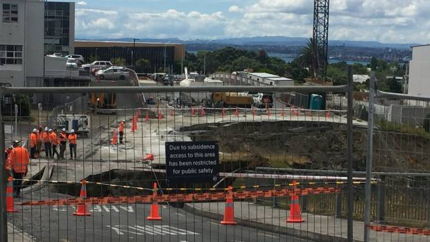 Huge slip in North Shore carpark widens, swallowing