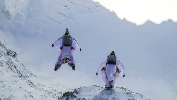 Wingsuit flyers Fred Fugen and Vince Reffet jump off the summit of Jungfrau mountain